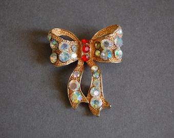 Red Rhinestone Gold Bow Pin