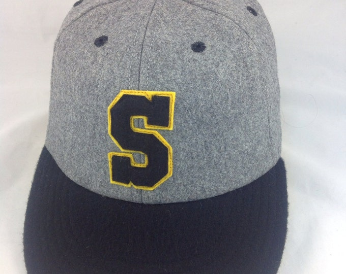 S felt logo custom  cap, 6 panel soft wool flannel with supple leather sweatband. Any letter available in any color.