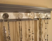 jewelry hanger with dcorative acrylic and  glass knobs on gray with white embossed background 15 inches long closet