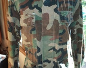 Vintage Military Jacket, Army Issued Camouflage Uniform Jacket with many pockets to hold things from the Viet Nam War Era in Vintage Shape