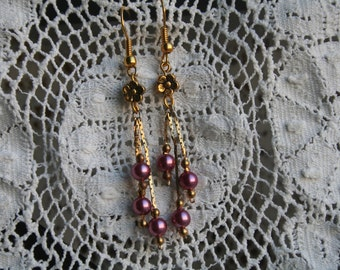 Pretty gold dangle earrings w/ pink glass pearls, and gold flower beads.