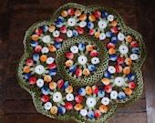 Multi-colored eleven inch crocheted doilie