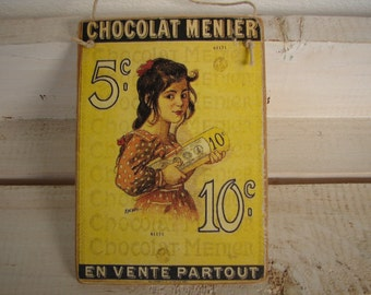 vintage CHOCOLAT MENIER French advertising shop label, chocolate sold here, decorative hanging tag.