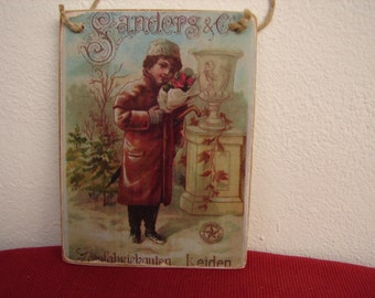 sanders & co. vintage advertising image, child winter scene on wood, hanging tag
