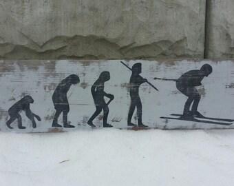 Weathered SKIER EVOLUTION Sign, old ski sign