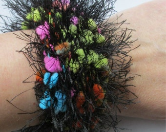 knit cuff bangle in black eyelash and neon popcorn yarn