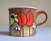 Coffee mug with daisies, sunflowers and poppies