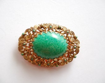 Vintage Goldtone Brooch with Green Stones Austria