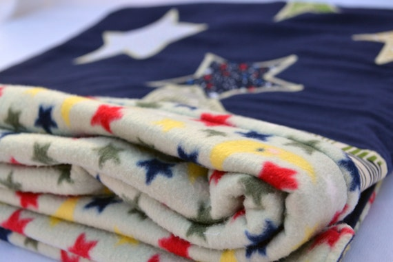 Primary color moon and stars fleece baby blanket quilted for Moon fleece fabric