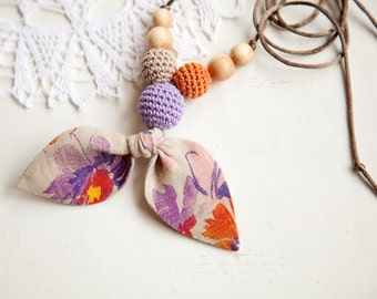 Fabric nursing necklace - linen bow - lilac beads