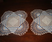 Pair of blue and white doilies