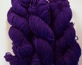 Grape Juice on Octosport  SW Merino Hand dyed Sport weight  yarn
