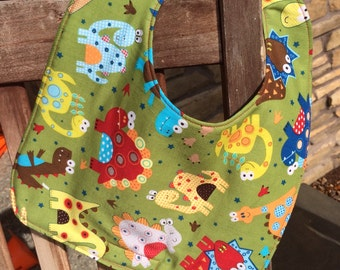 TODDLER of NEWBORN Bib: Tossed Dinosaurs, Personalization Available