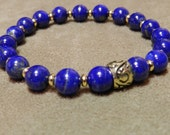 Intense Blue Lapis Lazuli with Gold Plated Heishi Spacers and an Antique Gold Bali Bead Stretch Bracelet