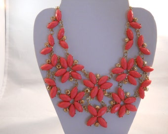 2 Row Bib Necklace with Gold Tone and Pink Flower Pendants on a Gold Tone Chain