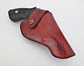 Leather holster for a .357 magnum Ruger ® SP 101 revolver.