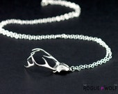 """The """"Remember"""" necklace in silver - An antler necklace with a hidden heart within its curves."""