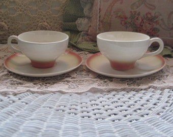 Two Cups and Saucer set Pretty Peachy Pink Color :)