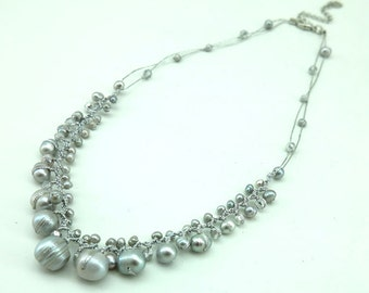 Light gray freshwater pearl on silk necklace.