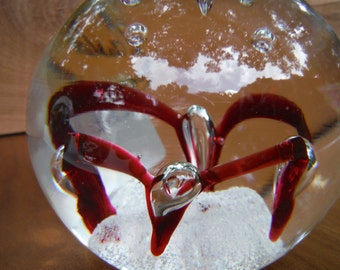 Jablonski paperweight with cranberry swirls and controlled bubbles