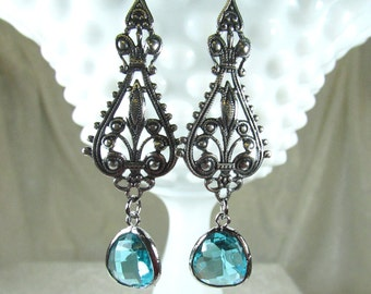 Fancy silver dangle earrings with faceted glass drops