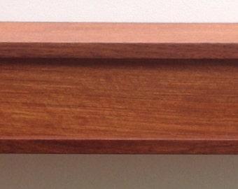 Solid jatoba floating shelf with sliding door