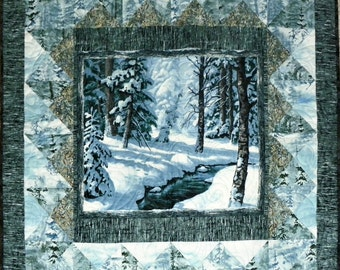 A Winter Scene in a quilted wall hanging.