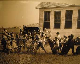 1930 playground fun, the boys against the girls