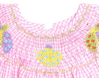 Smocked summer dress with large colorful bugs