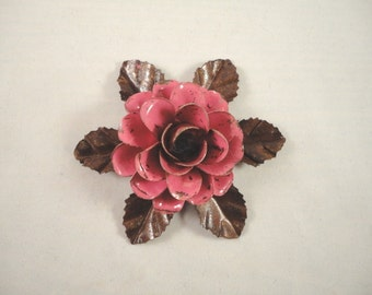 Medium Size Decorative Metal Hand Cut and Hand Painted Rustic Dark Pink Color Rose Mounted on a Bed of Leaves.