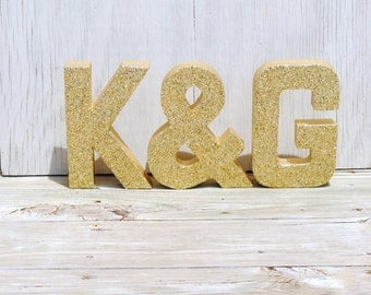 gold glitter stand up decorative letters and ampersand anniversary wedding reception table photo prop