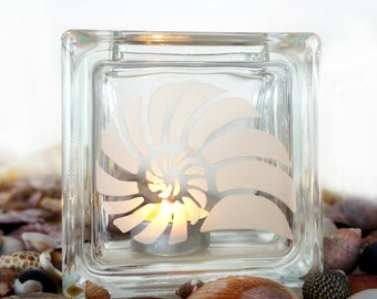 Glass tea light candle holder etched with seashell design