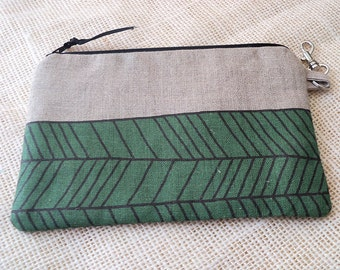 Herringbone zipper pouch on natural linen