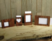 A set of 12th scale, free standing photo frames
