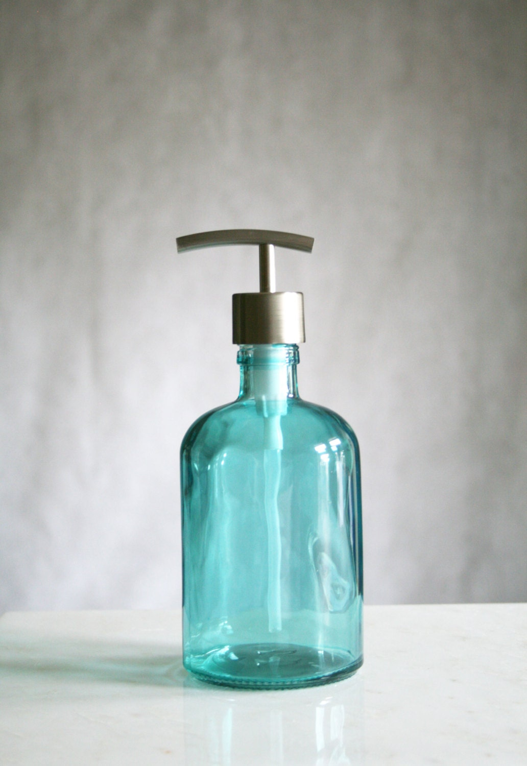 Choosing a glass soap dispenser doesn't mean limiting your choice in fit and finish. Glass hand soap dispensers come in a variety of looks, from clear crystal to flecked with color and much more. Whether it's a wall mounted soap dispenser or a free standing gel pump, glass can be the focal point of .