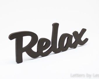 Wooden wall word Relax. Relax wooden wall sign