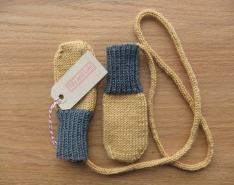 Hand knitted mustard and charcoal grey baby mittens with knitted string - available to order in sizes 0-3, 3-6 and 6-12 months