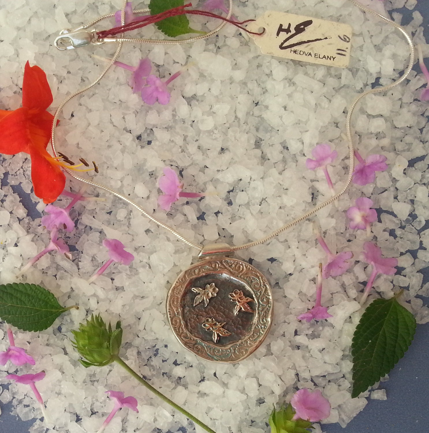Dancing flowers, Spring flowers in silver, yellow gold and rose gold, on a sterling silver round coin pendant