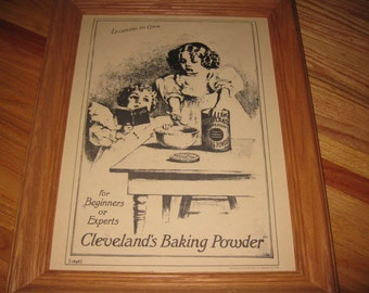 "CLEVELAND'S BAKING POWDER Learning To Cook Ad Framed In A 15"" x 18 1/2"" Oak Frame 1898 Reproduction"