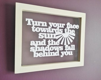 Hand cut papercut quote in a beautiful a4 floating frame. 'Turn your face towards the sun'