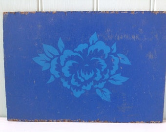 Original artwork of a bright blue flower on a darker blue background. Painted on wood,  no glass, easy to hang.