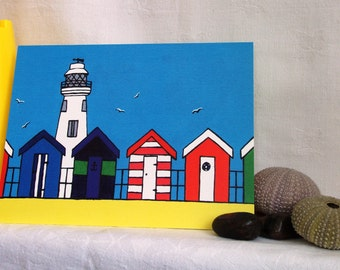 Lighthouse with huts greeting card