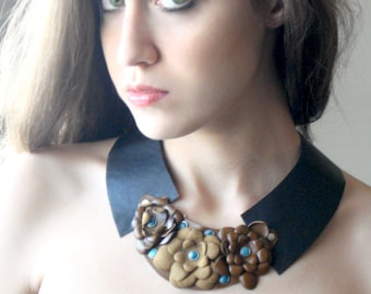 Turquoise, leather collar.
