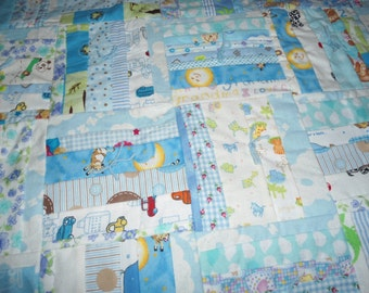 Boys Blue Baby Quilt with white sheep on blue ground on the backing