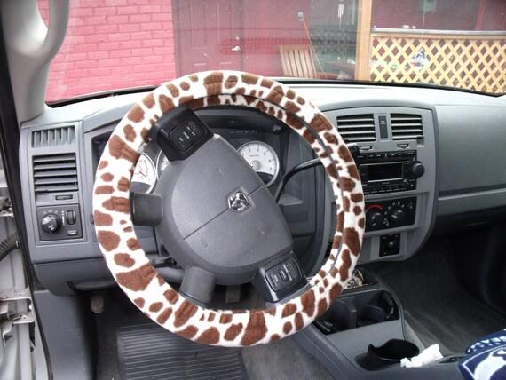 A Giraffe Print Steeling wheel cover custom made.