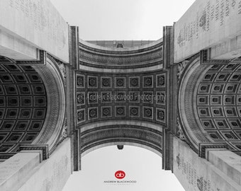 Looking up at the Arc de Triomphe