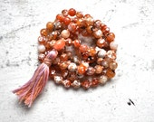 pink polished agate + multicolored tassel mala beads