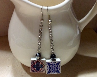 Pair of earrings with small replica of Portuguese tile, and chain detail.