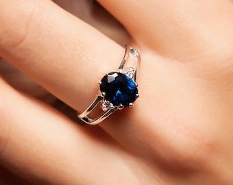 Iris. Handmade Sapphire and Zircon Ring
