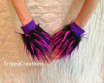 Fluffies black, pink, and purple spike fluffie wrist cuffs. Great for raves, festivals, and gogo dancers.